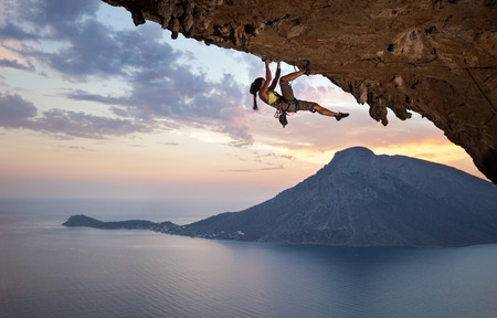 Young female rock climber at sunset, Kalymnos Island, Greece