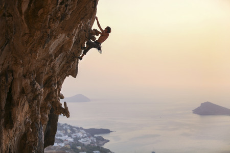 Male rock climber at sunset, Kalymnos Island, Greece
