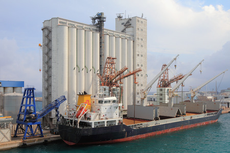 Elevator and bulk carrier with grain, seaport. Savona, Italy