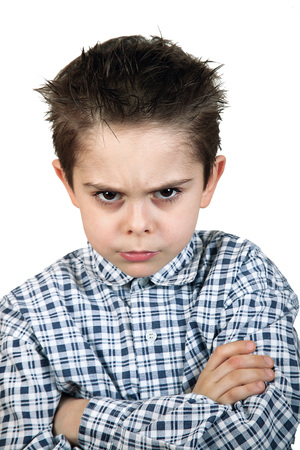 angry young boy on white background