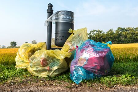 Photo for abandoned garbage bags near the lawn - Royalty Free Image