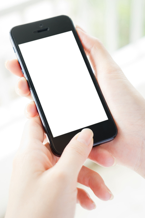 Photo for Woman typing on mobile phone isolated  white screen - Royalty Free Image
