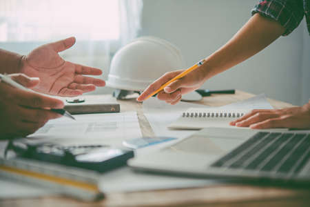 Photo pour engineer working in office with blueprints, inspection in workplace for architectural plan, construction project ,Business construction - image libre de droit