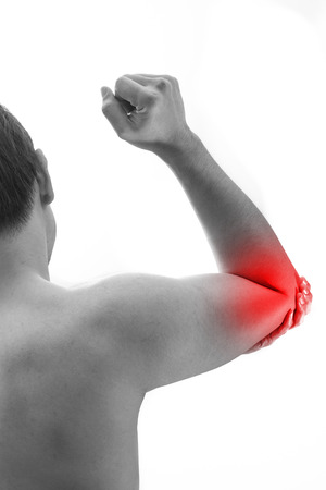 Man elbow pain. Male holding elbow to spot of elbow pain.