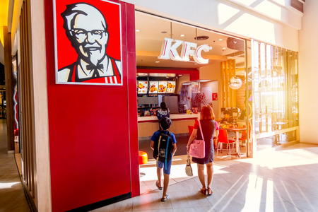 Photo pour KFC (Kentucky Fried Chicken) shop in super market most popular fast food restaurant and a favorite of parents and kids for family eating together times.Bangkok.,Thailand 29 April 2018. - image libre de droit