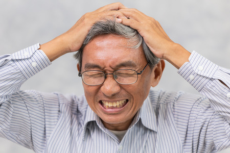 Asian elder suffer from stroke and powerful headache or brain attack