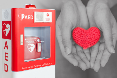 Photo pour AED or Automated External Defibrillator first aid help giving life heart concept - image libre de droit