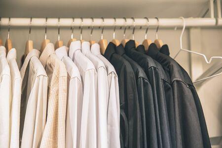 Photo pour Men Clothes business shirt hanging in the closet neatly vintage color tone. - image libre de droit