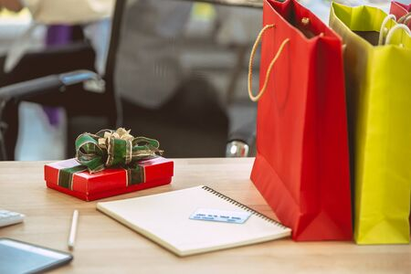 Photo for Closeup Gift box on the office table for surprise from working partner. - Royalty Free Image