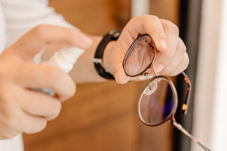 Foto de Eyeglass cleaner, hand spray cleaning glasses for clear vision and remove Sweat stains, oily stains and fingerprints. - Imagen libre de derechos