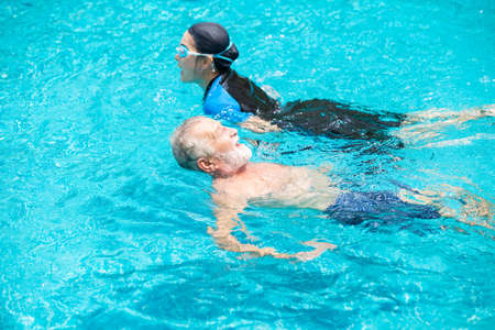 Photo pour elder swimming the pool together happy relax enjoy in summer season - image libre de droit