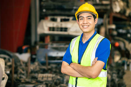 Photo pour confident Asian male engineer worker standing arm crossed happy smile for enjoy working in factory - image libre de droit