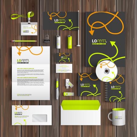 Foto de Black corporate identity template design with green and orange arrows. Business stationery - Imagen libre de derechos