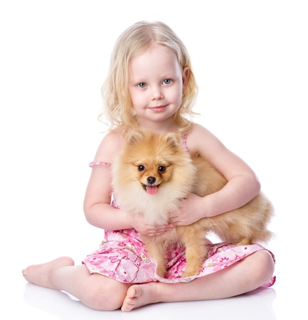 girl and puppy  looking at camera  isolated on white backgroundの写真素材