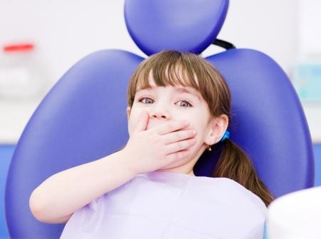 frightened girl at dentist s office