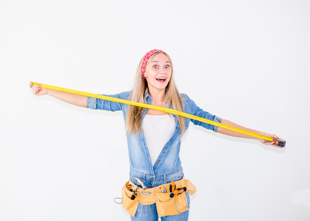 Happy woman with a measuring tape.