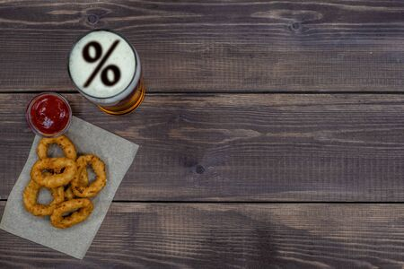 Photo pour Snacks with beer on dark wooden background. Top view. Empty space for text. - image libre de droit