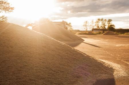 Grain storage silos. Harvest concepthill of grain, wheat, rye, barley, corn, rape, etc. Granary with mechanical equipment for receiving, cleaning, drying, grain shipment