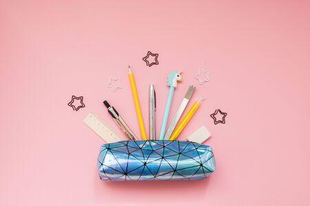 Photo pour Back to school. Pencil case with school supplies on pink table. - image libre de droit