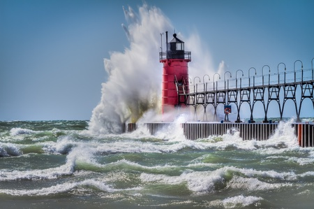 At South Haven, Michigan, the Lighthouse is pounded by waves during a windstorm