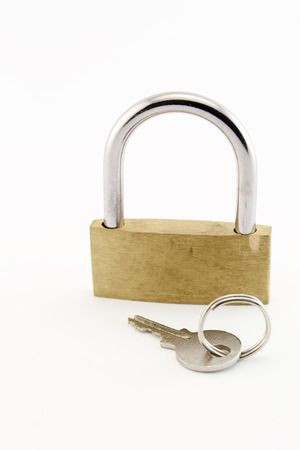 Keys and golden padlock. Isolated on a white background.