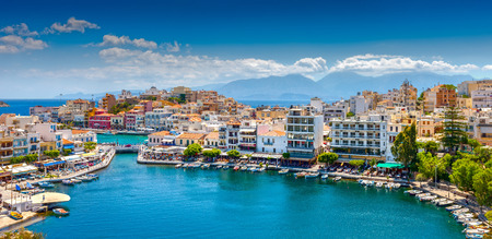 Photo for Agios Nikolaos  Agios Nikolaos is a picturesque town in the eastern part of the island Crete built on the northwest side of the peaceful bay of Mirabello  - Royalty Free Image