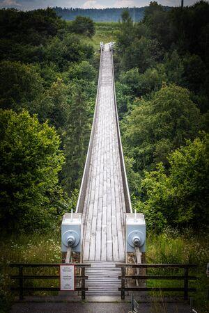 Suspension bridge St. Luzia on the bicycle track Drauradweg between Bleiburg and Neuhaus near the village Aich above the river Feistritz, Austria