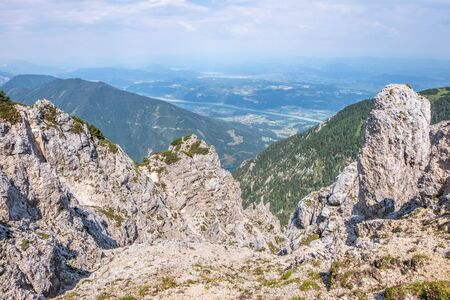 View from rocks on mountain Hochobir to valley Rosental with lake Freibach Stausee in Carinthia, Austria