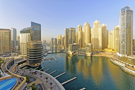 View of Dubai marina district. Dubai Marina is an artificial canal city built along a two mile 3 km stretch of Persian Gulf shoreline.  This district is in the heart of what has become known as new Dubai in Dubai United Arab Emirates.