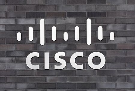 Wallisellen, Switzerland - 30 January, 2016: sign on the wall of the Cisco Systems GmbH office building. Cisco Systems is a multinational company that designs, manufactures and sells networking equipment.