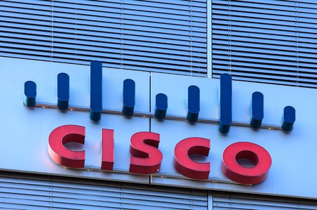 Wallisellen, Switzerland - 28 August, 2016: shutters and sign on the wall of of the Cisco Systems Switzerland office building. Cisco Systems is a multinational technology company headquartered in San Jose, California. It designs, manufactures and sells ne
