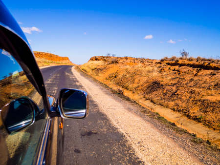 Photo pour Driving a car on scenic Route Nationale 7 (RN7) through the savannah of Madagascar highlands - image libre de droit