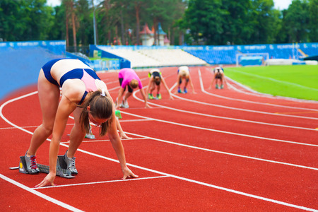 sportswomen at the start, sports background