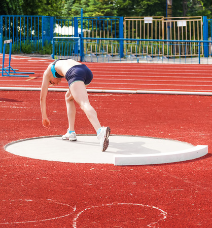 Woman athlete in throwing of kernels