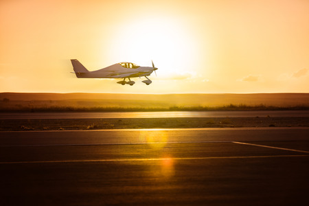 Photo for small plane on the runway background of sunrise - Royalty Free Image