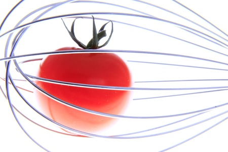 tomato in a whisk