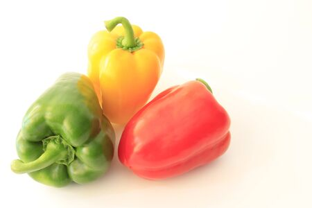 three peppers in differernt colors