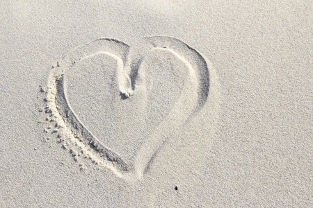 heart painted in the sand of a dune