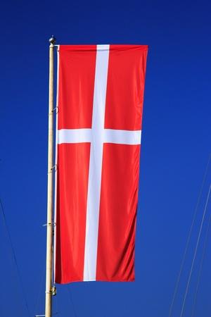Flag of Denmark before blue sky