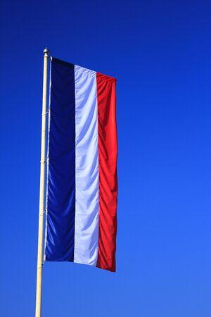 Flag of France before blue sky