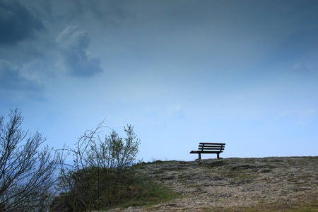 bench on a lonely cliff in bad weather