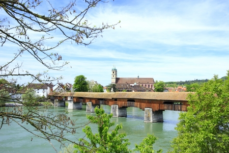 the famous covered wooden bridge over the Rhine from the German shore