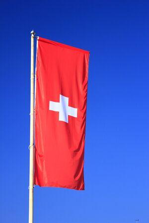 Flag of Switzerland before blue sky