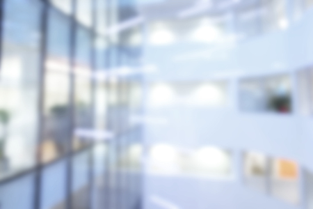 Photo pour Out of focus or blurred  office background of Large atrium lit by suspension lights, overlooking offices. - image libre de droit