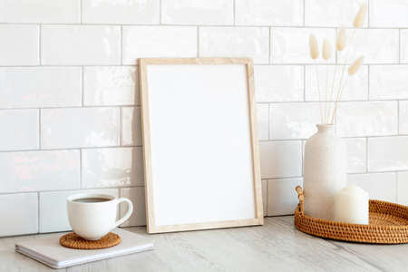 Photo for White picture frame mockup and home decor on table. Scandinavian living room interior design. Nordic style. - Royalty Free Image