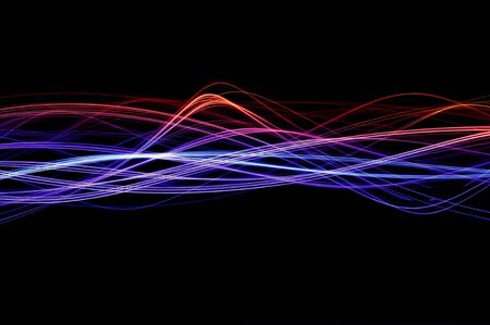 Red, blue and purple waveforms of light on a black background