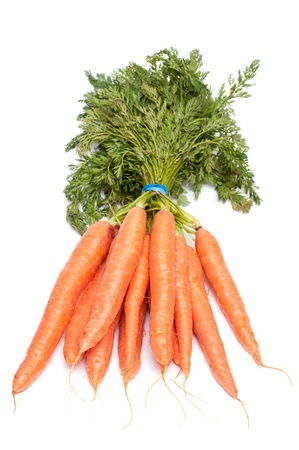 Bunch of orange carrots on a white background