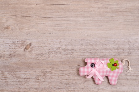 Pink pig with green shamrock as lucky charm