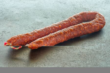 Hot shorizo pepper salami sausage on baking sheetの写真素材