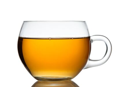 Photo for Glass cup of orange black tea in back lit close-up - Royalty Free Image